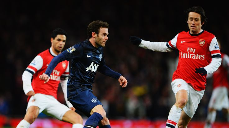 LONDON, ENGLAND - FEBRUARY 12:  Juan Mata of Manchester United and Tomas Rosicky of Arsenal challenge for the ball during the Barclays Premier League match