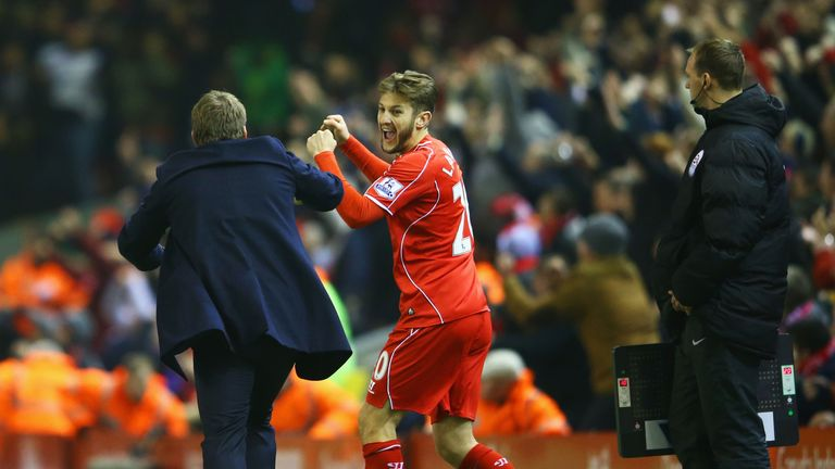 Brendan Rodgers celebrates with Adam Lallana after Glen Johnson (not pictured) scores the winning goal