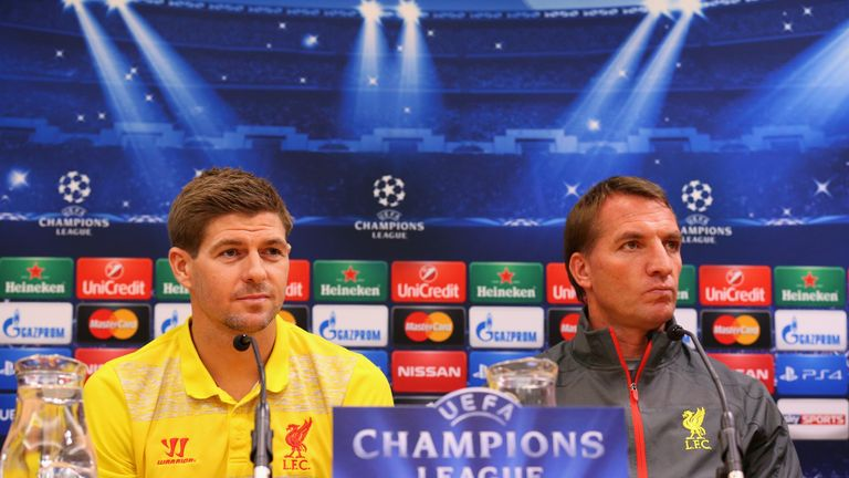 Brendan Rodgers the manager of Liverpool and Steven Gerrard face the media during a press conference at Anfield