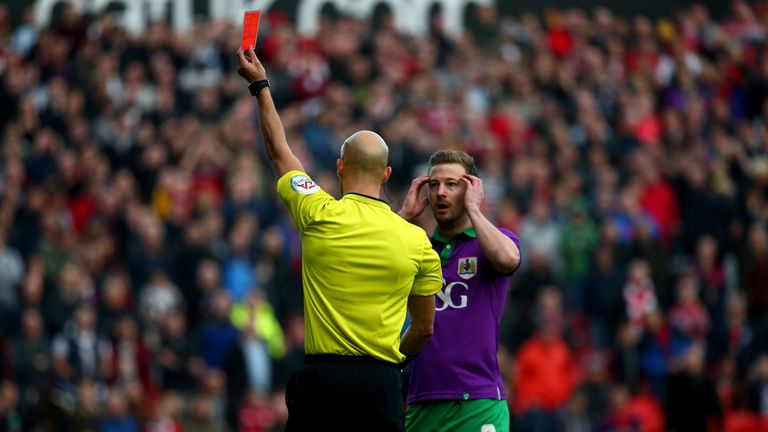 Wade Elliott of Bristol City reacts as is sent off by referee Darren Drysdale