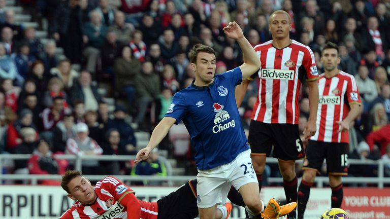 SUNDERLAND, ENGLAND - NOVEMBER 09:  Connor Whickham (L) of Sunderland concedes a penalty with a challenge on  Seamus Coleman of Everton shoots to score a p