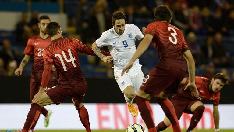 Danny Ings of England U21 takes on the Portugal defence