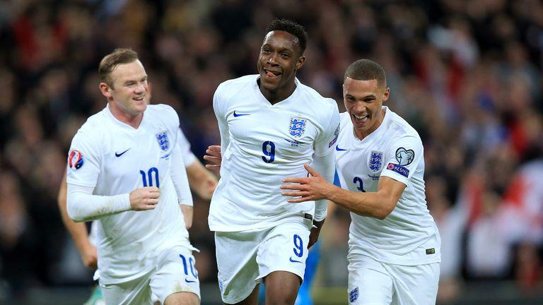 England's Danny Welbeck (centre) celebrates with team-mates Kieran Gibbs (right) and Wayne Rooney v Slovenia, European Qualifiers