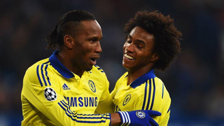 Drogba celebrates Chelsea's fourth goal of the night against Schalke