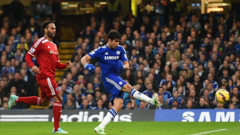 Diego Costa of Chelsea scores the opening goal under pressure from Joleon Lescott