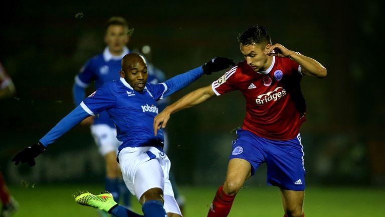 Nigel Atangana of Portsmouth tackles Brett Williams of Aldershot
