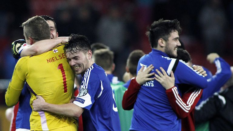 Faroe Islands players celebrate their win