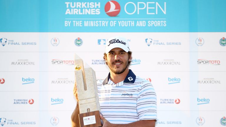 Koepka poses with the trophy after securing victory in the 2014 Turkish Airlines Open