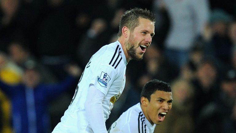 Swansea players Gylfi Sigurdsson (l) and Jefferson Montero celebrate
