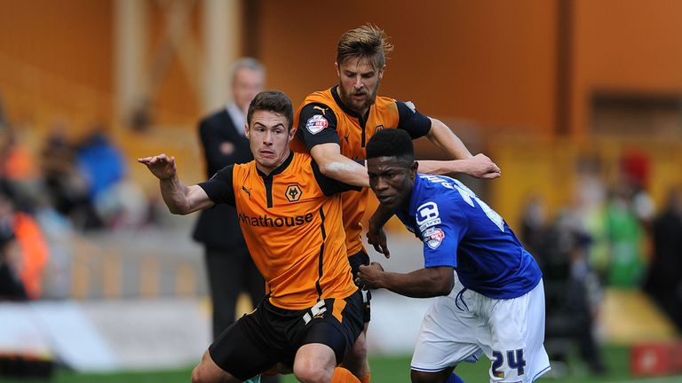 Birmingham's Koby Arthur (right) is put under pressure against Wolves