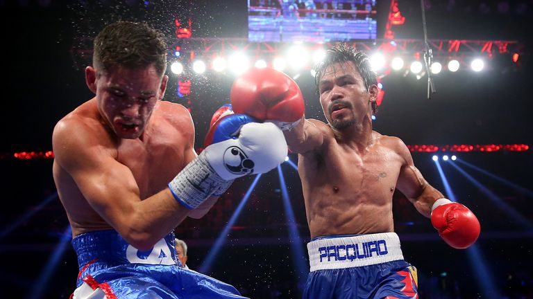 MACAU - NOVEMBER 23:  Manny Pacquiao of the Philippines punches Chris Algieri of the United States during the WBO world welterweight title at The Venetian