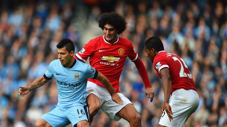 MANCHESTER, ENGLAND - NOVEMBER 02:  Sergio Aguero of Manchester City is closed down by Marouane Fellaini and Luis Antonio Valencia of Manchester United