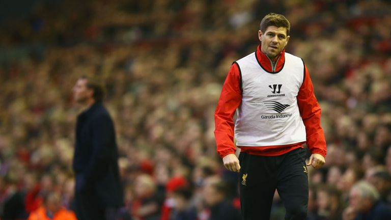 Substitute Steven Gerrard warms up as Brendan Rodgers stalks the touchline