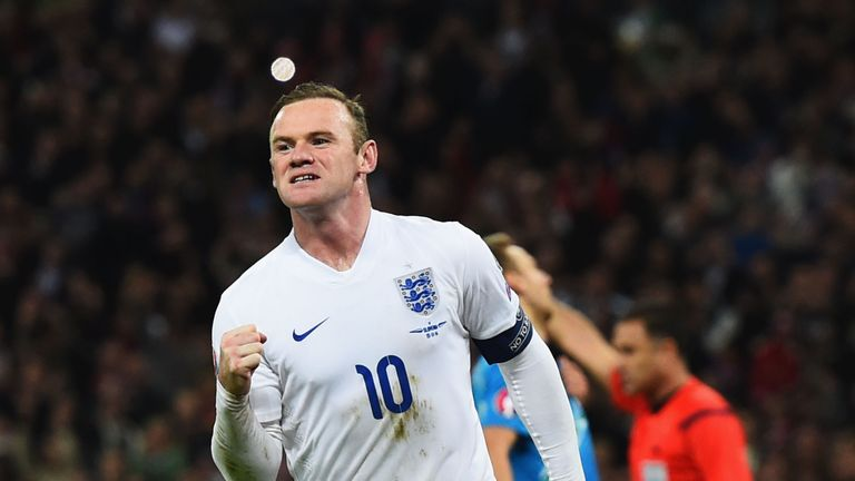 Wayne Rooney of England celebrates as he scores their first and equalising goal from a penalty during the European Qualifier v Slovenia at Wembley