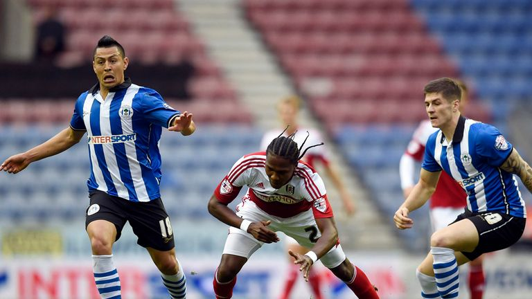 Hugo Rodallega (centre): Fulham striker takes a tumble at Wigan