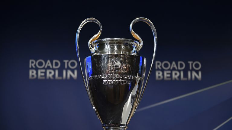 The Champions League trophy stands on a podium