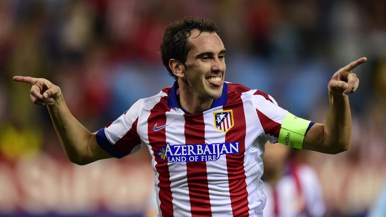 Atletico Madrid's Uruguayan defender Diego Godin celebrates after scoring their fourth goal during the UEFA Champions League match v Malmo