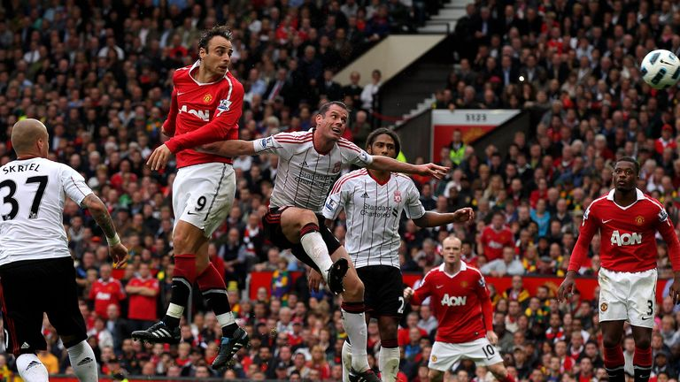 Dimitar Berbatov of Manchester United scores his team's third goal to complete his hat-trick during the Premier League game against Liverpool in 2010
