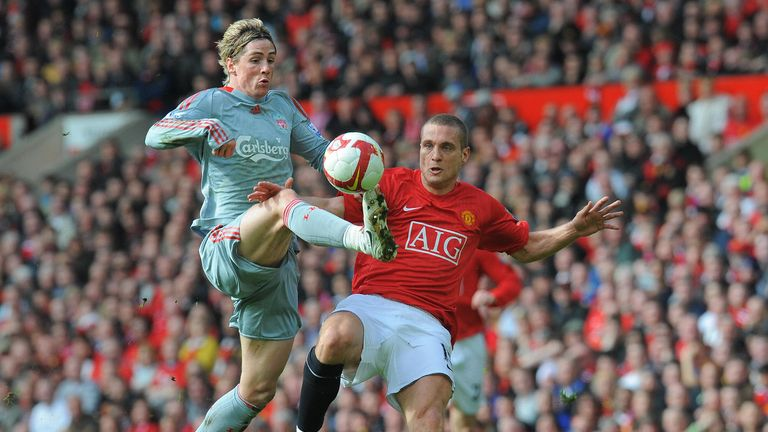 Liverpool  forward Fernando Torres beats Manchester United defender Nemanja Vidic to score the equalising goal during the Premier League game in March 2006