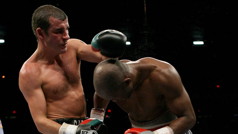 LAS VEGAS, NEVADA - APRIL 19:   Joe Calzaghe (L) throws a clubbing left hook against Bernard Hopkins during their Light Heavyweight bout on  April 19, 2008
