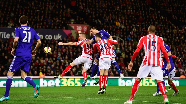 Chelsea player John Terry (c) heads in the opening goal during the Barclays Premier League match between Stoke City and Chelsea at the Britannia Stadium