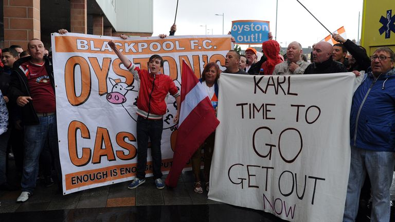 Blackpool fans hold a protest outside the ground against club chairman Karl Oyston during a Pre Season Friendly match