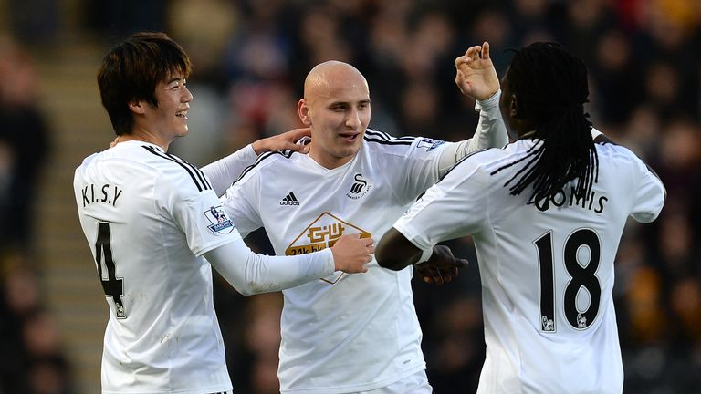 Ki Sung-Yueng of Swansea City celebrates scoring the only goal with Jonjo Shelvey and Bafi Gomis