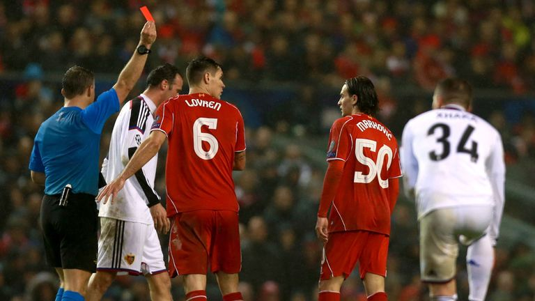 Liverpool's Lazar Markovic is shown the red card by referee Jorn Kuipers during the UEFA Champions League Group B game at Anfield, Liverpool