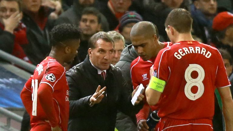 Liverpool's Steven Gerrard (right) and Raheem Sterling (left) receive instructions from manager Brendan Rodgers on the touchline