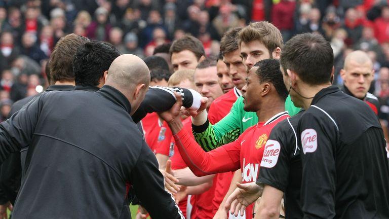 Luis Suarez refuses to shake the hand of Patrice Evra