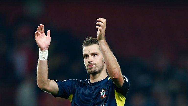 Morgan Schneiderlin of Southampton thanks the support at full time during the Capital One Cup Third Round match at Arsenal
