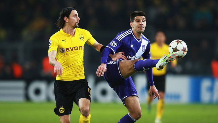 Neven Subotic: Closes down Anderlecht's Aleksandar Mitrovic during draw