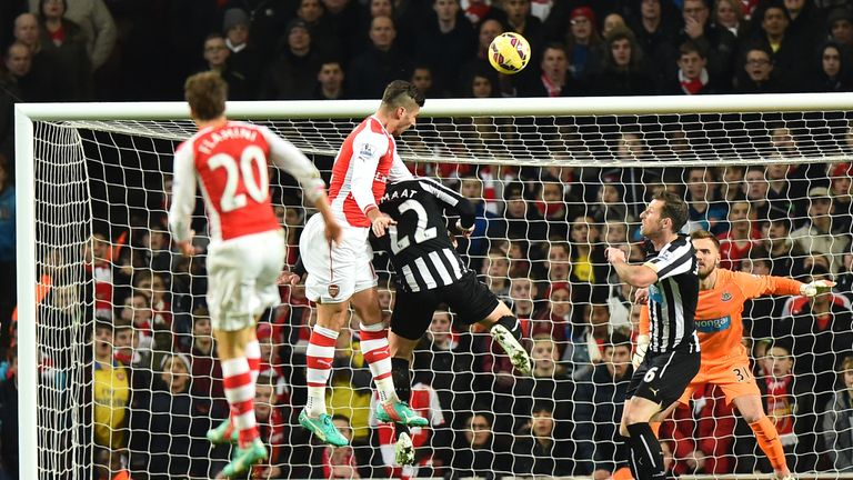 Arsenal's Olivier Giroud rises highest to score the opening goal against Newcastle