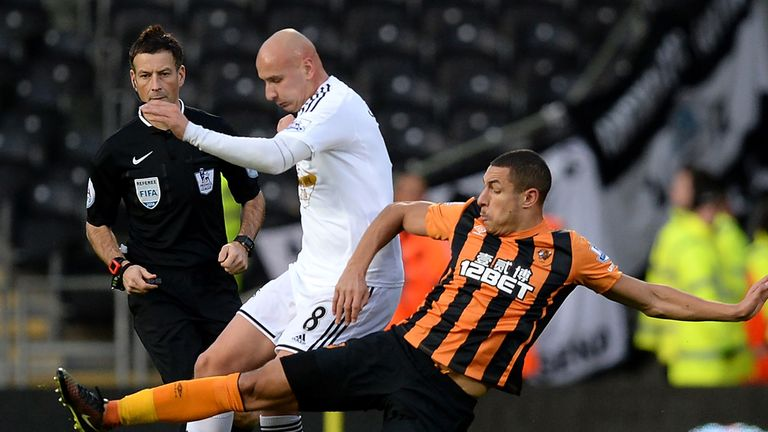 Jake Livermore tackles Jonjo Shelvey
