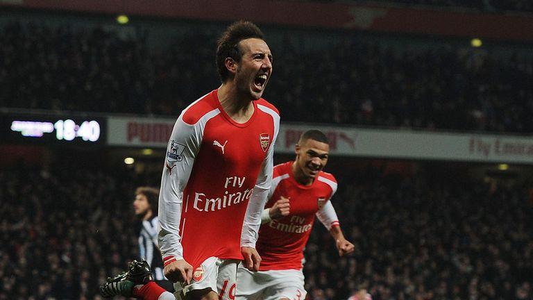 Santi Cazorla celebrates scoring