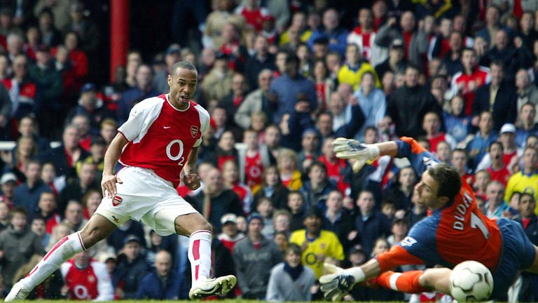 Henry beats Liverpool's Jerzy Dudek for his second during the 4-2 win at Highbury