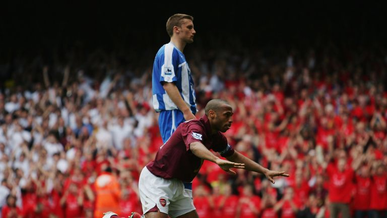 Henry celebrates scoring his team's fourth goal by bowing to the North Bank against Wigan in May 2006