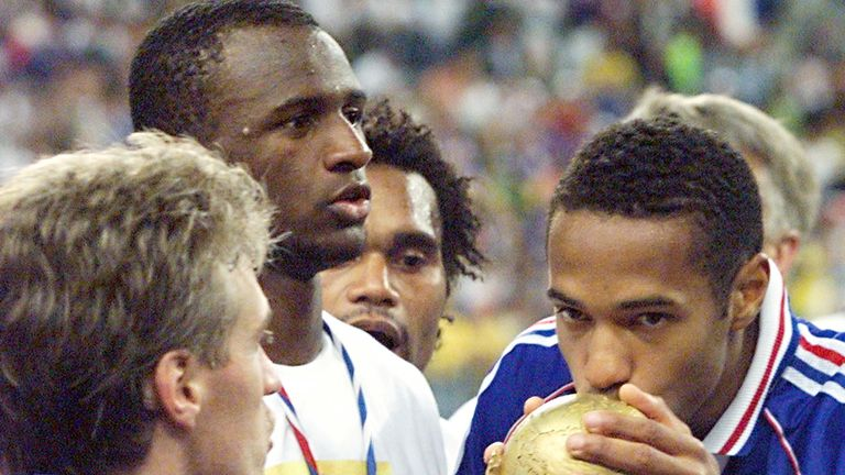 World champion! Henry kisses the World Cup after victory over Brazil in the 1998 final.