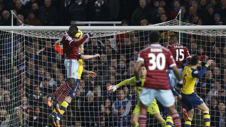 West Ham United's Senegalese midfielder Cheikhou Kouyate jumps highest to pull a goal back against Arsenal.