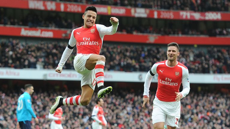 Sanchez celebrates scoring one of two goals against Stoke City in a 3-0 win on Sunday
