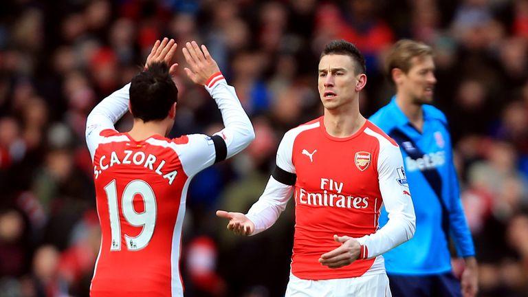 Arsenal's Laurent Koscielny celebrates scoring the opening goal of the game with Santi Cazorla