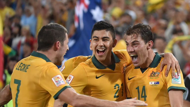 Australia's James Troisi (right) celebrates his winning goal.