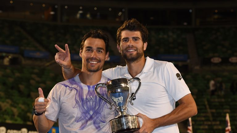 Italy's Fabio Fognini and Simone Bolelli pose with the trophy as they celebrate after victory in their men's doubles win