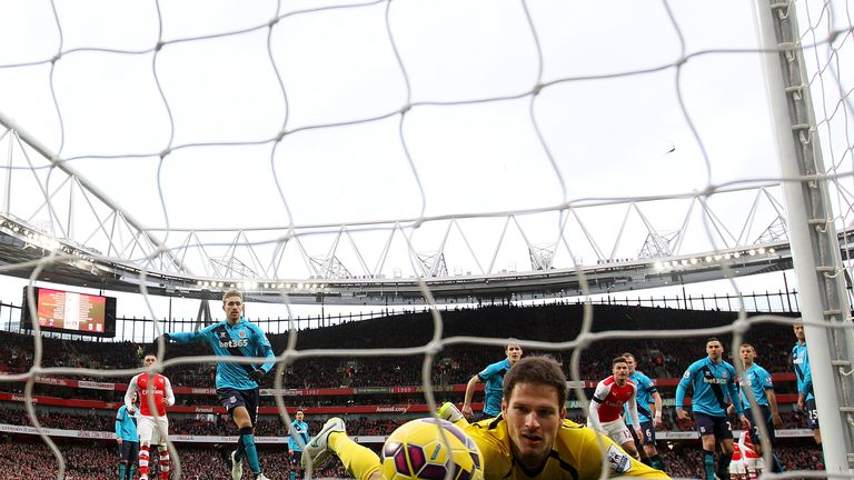 Asmir Begovic fails to stop the ball crossing the line as Alexis Sanchez (not pictured) of Arsenal scores his team's third goal from a freekick.