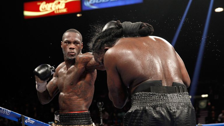 Deontay Wilder connects on WBC heavyweight champion Bermane Stiverne during their title fight.