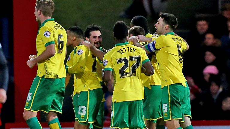 Cameron Jerome mobbed by Norwich team-mates after firing winner