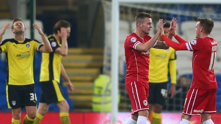 Joe Ralls celebrates scoring the opening goal against Colchester with Craig Noone .
