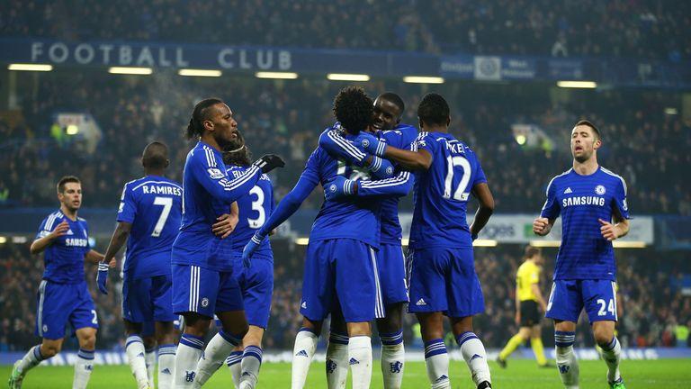 LONDON, ENGLAND - JANUARY 04:  Loic Remy of Chelsea (18) is congratulated by Kurt Zouma (5) and team mates as he scores their second goal during the FA Cup