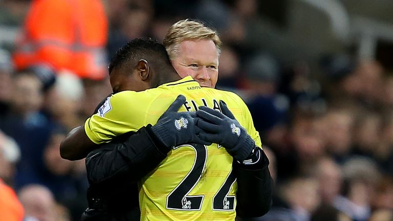 Eljero Elia celebrates with Ronald Koeman, manager of Southampton, after scoring the opening goal during the  Premier League match against Newcastle