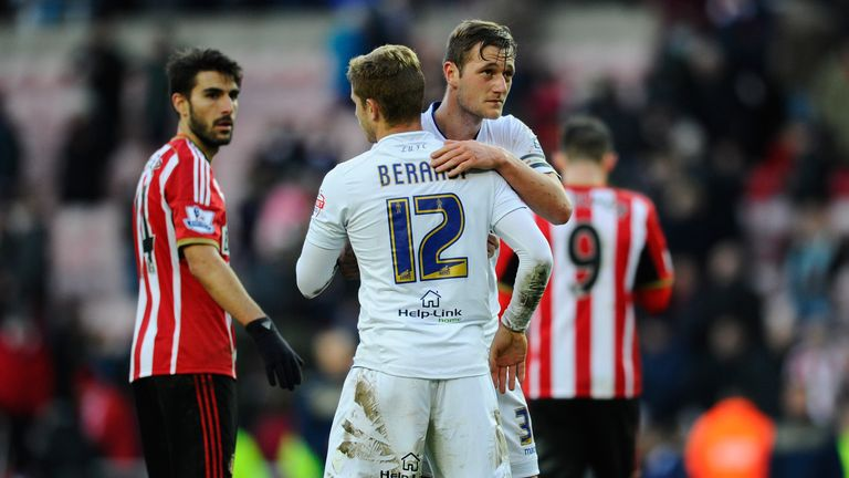 Gaetano Berardi: Embraces Leeds captain Liam Cooper after his injury-time header hit the post